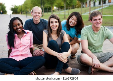 Diverse group of friends outside smiling together