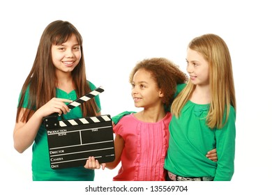 diverse group of girls with one holding film slate