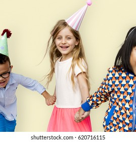 Diverse Group Of Kids Holding Hands in Festive Hat