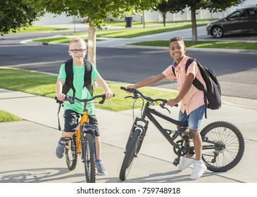 Diverse group of kids riding their bikes to school together