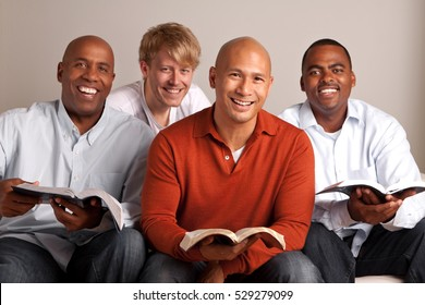 Diverse group of men in a small group.  Study group.