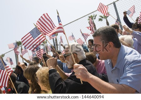 Diverse group of people with American flag during a rally
