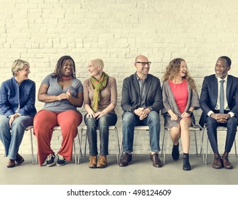 Diverse Group of People Community Togetherness Sitting Concept