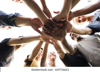 Diverse Group of People Hands Together Partnership Teamwork