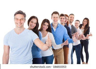 Diverse group of people standing in row and showing thumbs up. Isolated on white