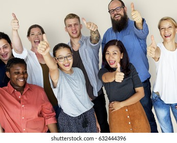 Diverse Group of People Thumbs Up Together Studio Portrait
