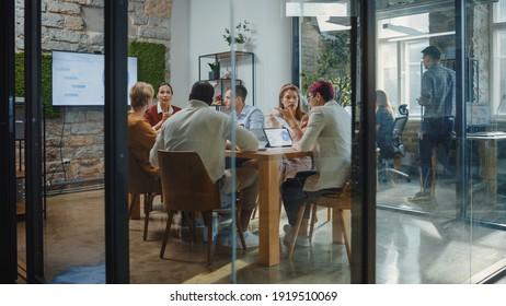 Diverse Group of Professional Businesspeople Meeting in the Modern Office Conference Room. Creative Team Discuss App Design, Analyze Data, Plan Marketing Strategy, Disrupt Social Media, Growth Hack