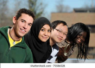 Diverse group of students smiling with selective focus on foreground person