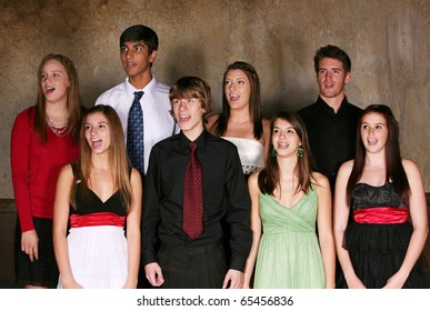 diverse group of teens singing and performing in choir in formal dress