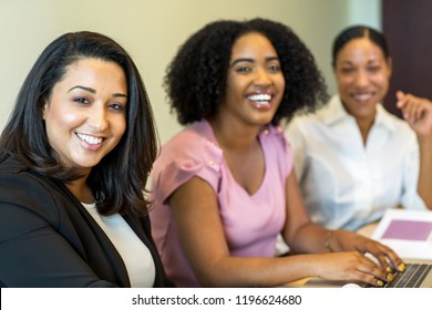 Diverse group of women at work.