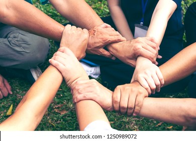 Diverse hand fist touching together in circle shap,show power of cooperation.