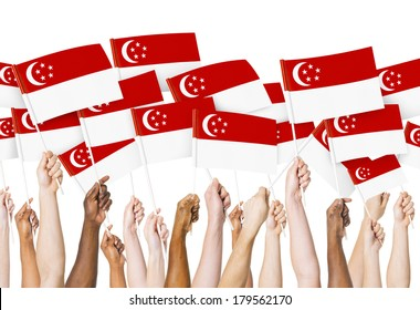 Diverse hands Holding Flags of Singapore