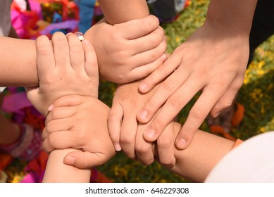 Diverse hands are join together