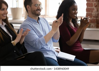 Diverse happy business team audience people listeners group applauding sit on chairs clapping hands at corporate training conference seminar meeting thank for presentation, applause ovation concept