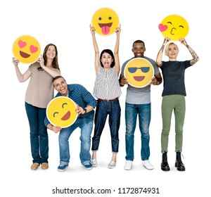 Diverse happy people holding happy emoticons