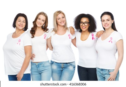 diverse, healthcare and people concept - group of happy different size women in white t-shirts with pink breast cancer awareness ribbon
