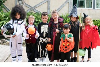 Diverse kids in Halloween costumes