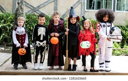 Diverse kids in Halloween costumes