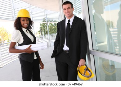 A diverse man and woman working as architect on a construction site
