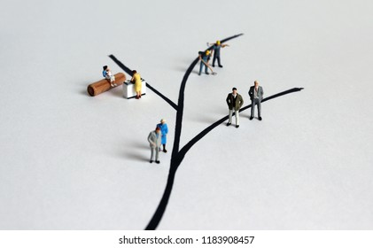 Diverse miniature people. The concept of role conflict in society and at home.