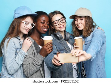Diverse multi nation female group, african-american and caucasian teenage friends company make selfie