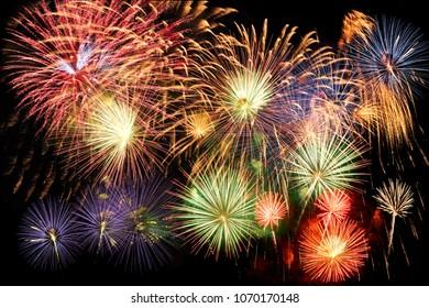 Diverse multicolor fireworks over a dark background