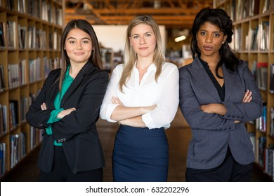 Diverse multiethnic group of business women make strong team powerful stare confident and successful