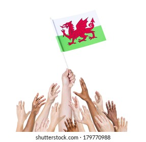 Diverse and Multiethnic Hands Holding The Flag of Wales