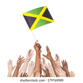 Diverse Multiethnic Hands Holding and Reaching For The Flag of Jamaica