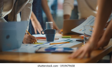 Diverse Multi-Ethnic Team of Professional Businesspeople Meeting in the Modern Office Conference Room. Creative Team Gathers Around Table to Discuss Plan Strategy. Close-up Shot with Focus on Hands - Shutterstock ID 1919479658