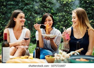 Diverse people enjoying food togethr