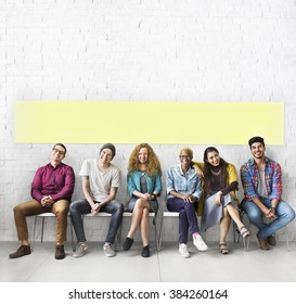 Diverse People Sitting Cheerful Wall Concept