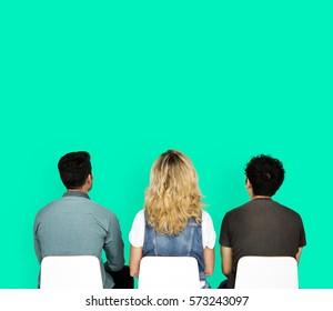 Diverse People Sitting Studio Portrait Concept
