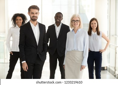 Diverse professional business team people portrait, smiling multiracial employees, company staff members, corporate workers group and leaders executives standing in modern office looking at camera