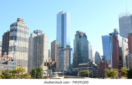 Diverse skyscrapers and apartment buildings at the intersection of 38th Street and 10th Avenue in New York City.
