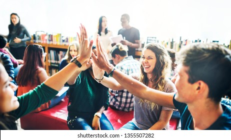 Diverse students giving high five to team