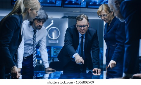 Diverse Team of Corporate Businesspeople Have Heated Discussion While Standing Around the Digital Touch Screen Table. Board of Directors of Import / Export Company Have Meeting.