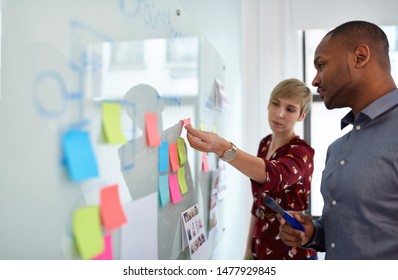 Diverse team of creative millennial coworkers in a startup brainstorming strategies