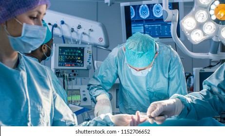 Diverse Team of Professional Surgeons Performing Invasive Surgery on a Patient in the Hospital Operating Room. Nurse Hands Out Instruments to surgeon, Anesthesiologist Monitors Vitals. Modern Hospital