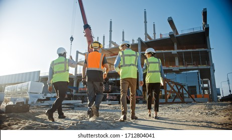 Diverse Team of Specialists Inspect Commercial, Industrial Building Construction Site. Real Estate Project with Civil Engineer, Investor and Worker. In the Background Crane, Skyscraper Formwork Frames