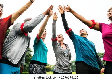 Diverse team stacking their hands