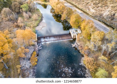a diversion dam on the Cache la Poudre River at a canyon mouth above Fort Collins, Colorado - aerial view with fall scenery