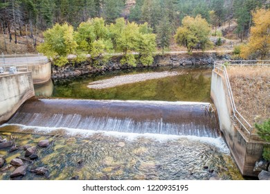 a diversion dam on the Cache la Poudre River at a canyon above Fort Collins, Colorado - aerial view with fall scenery