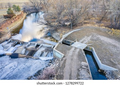 a diversion dam on the Cache la Poudre River in northern Colorado - aerial view with late fall or winter scenery