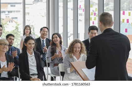 Diversity business audience group smiles and happy listening to male speaker giving a speech in corporate seminar event at conference room.