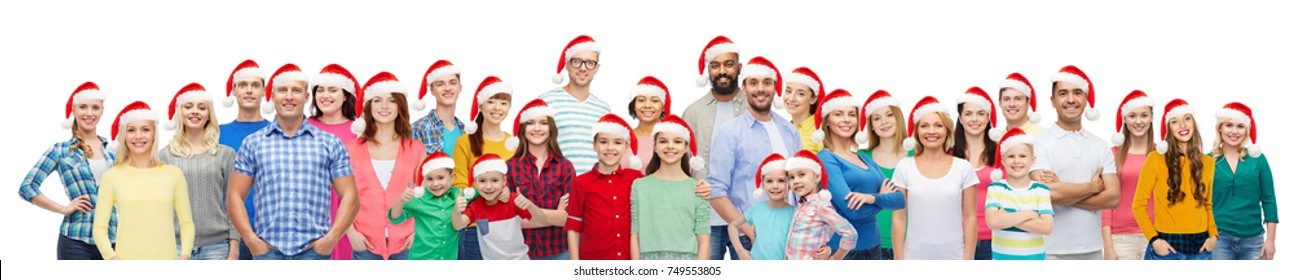 diversity, christmas and holidays concept - international multiethnic group of happy people in santa hats