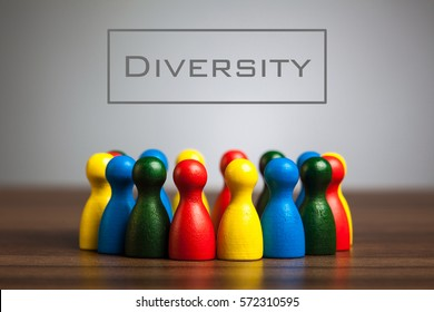 Diversity concept with pawn figurines on table, grey background