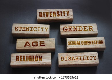 Diversity ethnicity gender age sexual orientation religion disability words written on wooden block. Equality and diversity concept.