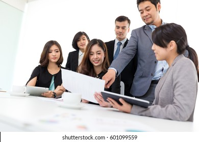 Diversity Group of business people discuss in meeting room