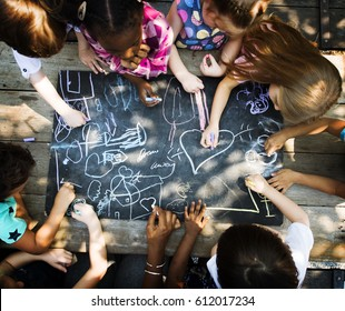 Diversity Group Of Kids Drawing Chalk Board
